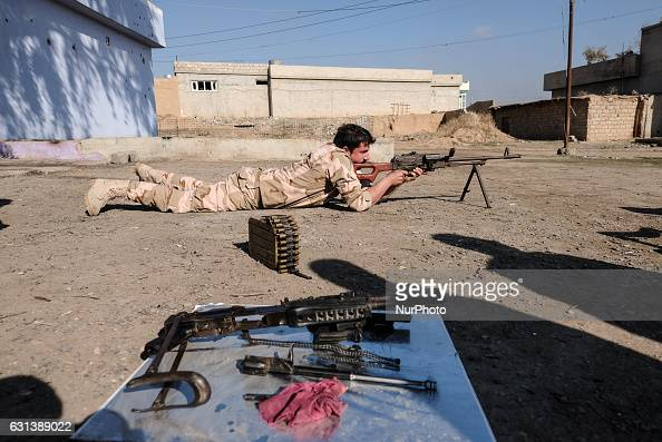 January 2017 Wardak Iraq Peshmerga soldier posing with heavy machine gun The Kakai Kurds are returning to their homes as Mosul offensive continiues...