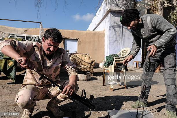 January 2017 Wardak Iraq Peshmerga soldiers cleaning their weapon The Kakai Kurds are returning to their homes as Mosul offensive continiues The...