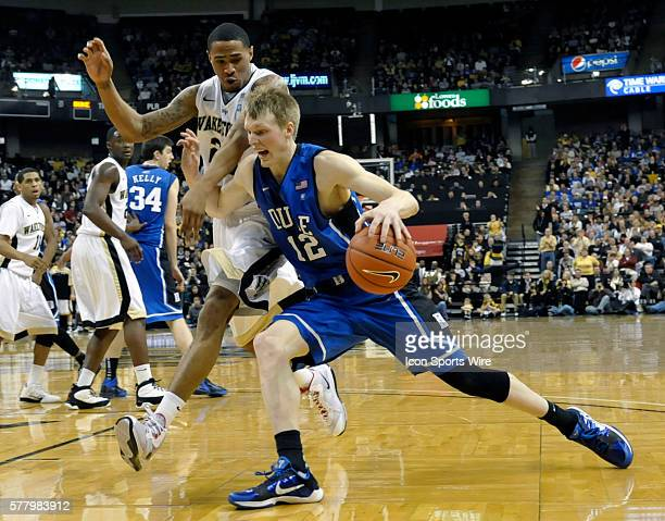 Duke forward Kyle Singler drives around Wake Forest forward Ari Stewart during the Duke Blue Devil's 8359 win over the Wake Forest Demon Deacons at...