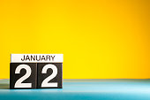 January 22nd. Day 22 of january month, calendar on yellow background. Winter time. Empty space for text.