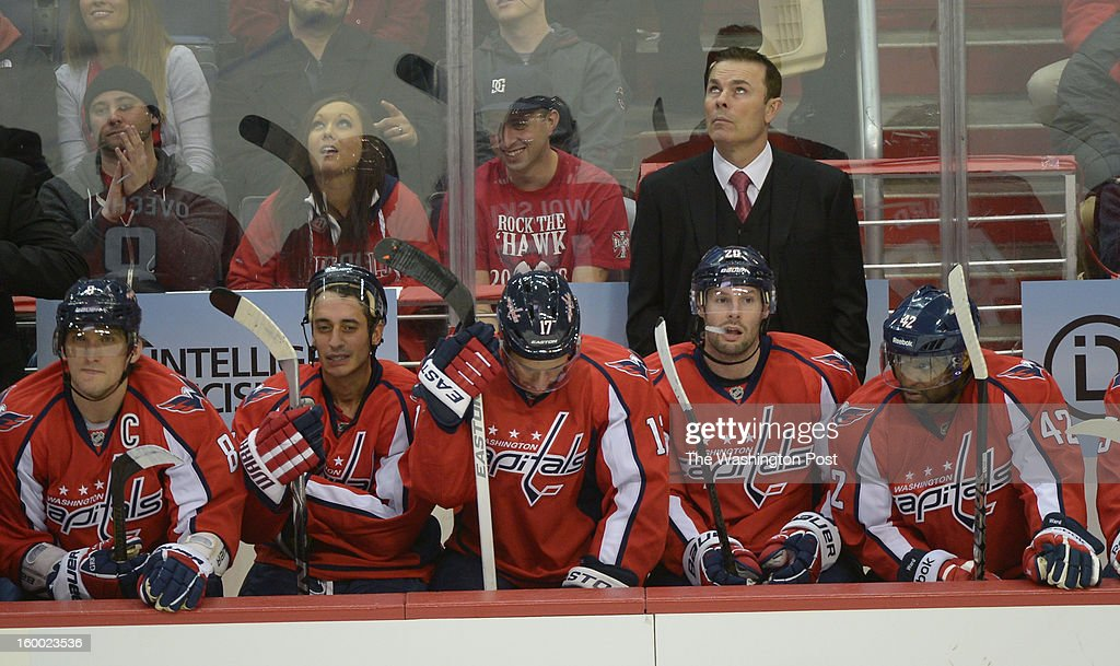 Washington Capitals head coach Adam Oates looks up as time runs off the clock in their 4-1 loss to the Montreal Canadiens on January 24, 2013 in Silver Spring, MD