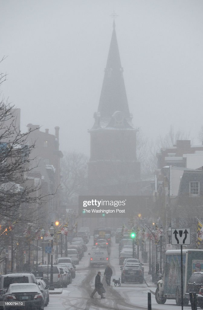 Snow arrives late in the day on Friday blanketing Main street in Annapolis. Up to two inches is expected in the area on January 25, 2013 in Annapolis, MD