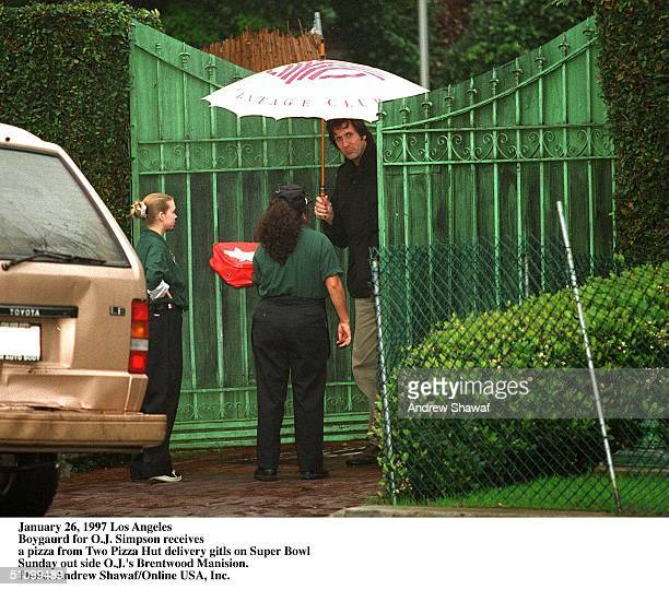 January 26 1997 Los Angeles Super Bowl Sunday OJ Simpson's Bodyguard Receives A Pizza From Two Pizza Hut Delivery Girls