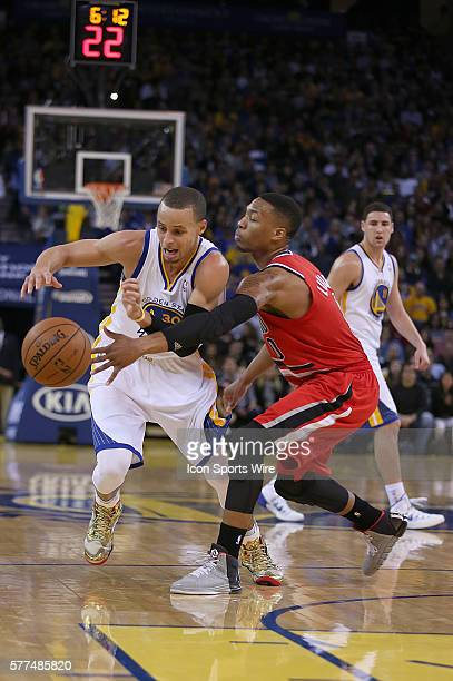 January 26 2014 Oakland CA Golden State's Stephen Curry and Damain Lillard battle for a loose ball during the Warriors 10388 victory over the...