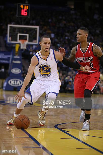 January 26 2014 Oakland CA Golden State's Stephen Curry drives around Damain Lillard during the Warriors 10388 victory over the Portland Trail...