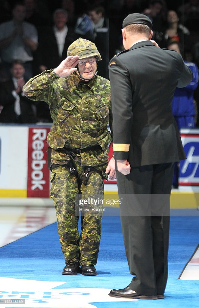 January 30, 2010 WWII vetern and Maple Leaf great Johnny Bower salutes Chief of Defence Staff, General Walter Natynczyk as the Toronto Maple Leafs wear camouflage jerseys to honour the Canadian Forces as the Toronto Maple Leafs host the Vancouver Canucks at the Air Canada Centre in Toronto. Toronto Star/Steve Russell