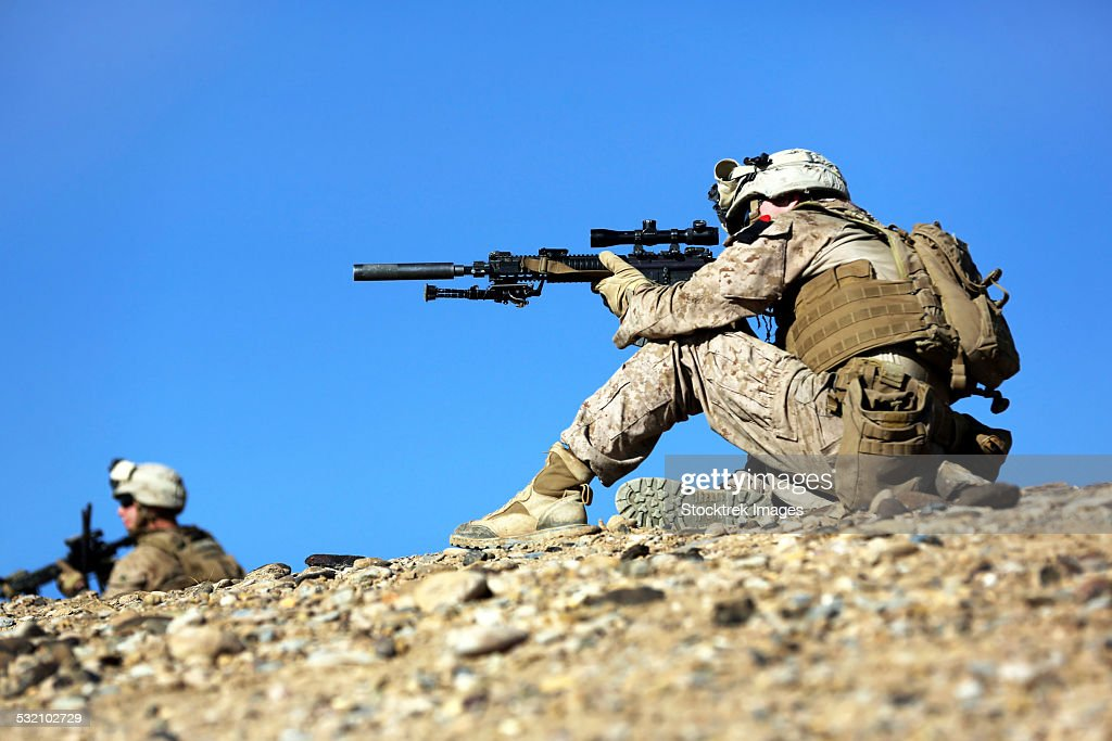 January 30, 2014 - U.S. Marines provide security during a patrol near Patrol Base Boldak in Helmand province, Afghanistan.