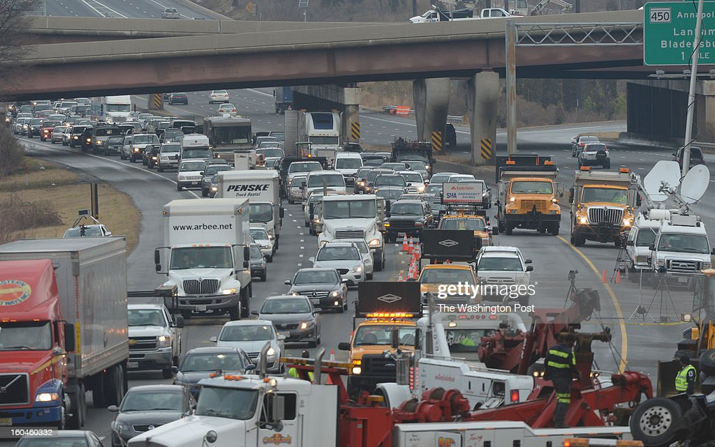 Emergency workers clear the tractor trailer that rear ended a firetruck sending 5 victims to area hospitals and causing massive delays on the inner and outer loops of the beltway on January 30, 2013 in Landover, MD