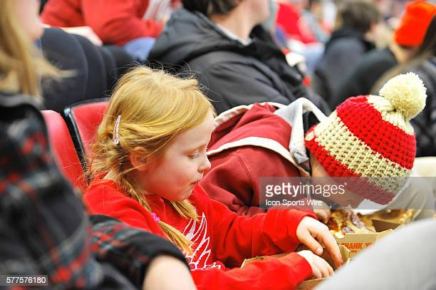 January 31 2014 Detroit MI These young Detroit Red Wings fans enjoy their pizza during the second period in the game on Friday evening Joe Louis...