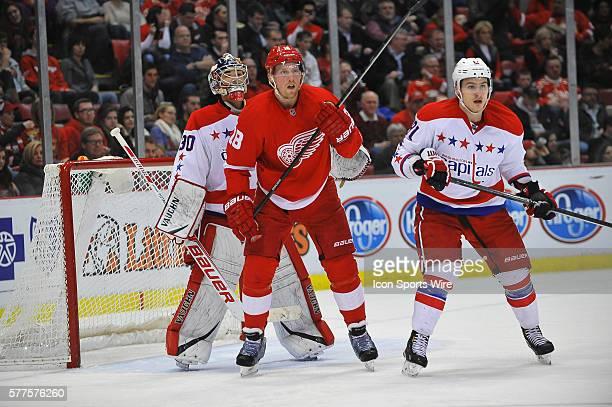 January 31 2014 Detroit MI Washington Capitals goalie Michal Neuvirth tries to look around Detroit Red Wings center Joakim Andersson with Washington...