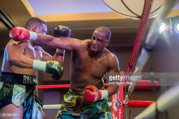 January 31 2014 Jon Miller misses Jarrell Miller with his right hook during the heavyweight fight at the XFE 35 Joey Eye Boxing event at Harah's...