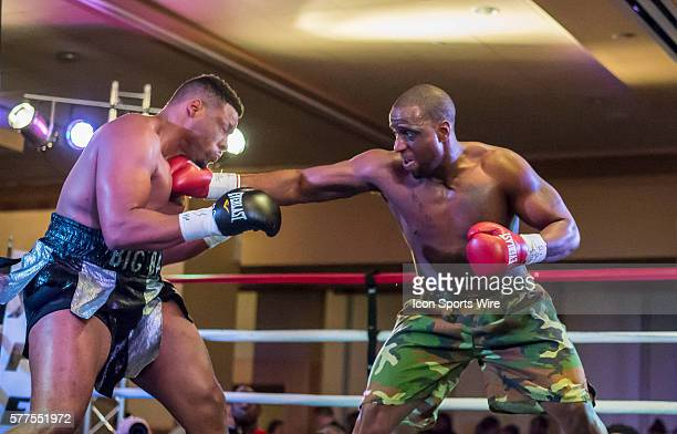 January 31 2014 Jon Miller plants a body blow to Jarrell Miller during the heavyweight fight at the XFE 35 Joey Eye Boxing event at Harah's Casino in...