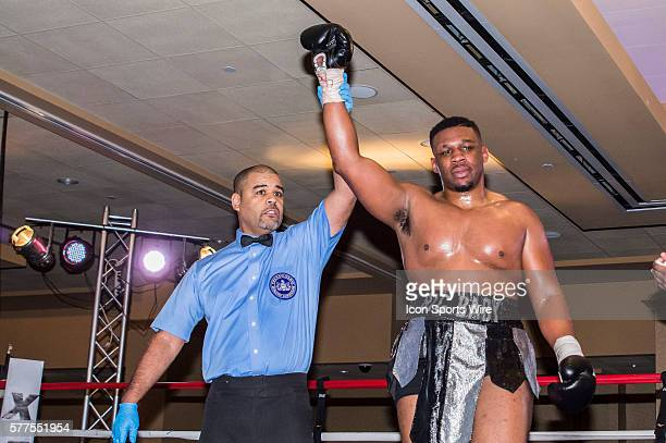 January 31 2014 winner Jarrell Miller raises his arm in victory after his Technical Knock Out during the heavyweight fight between Jarrell Miller and...