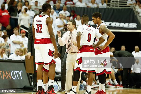 Louisville Cardinals head coach Rick Pitino speaks with his players during the NCAA mens basketball game between North Carolina Tar Heels and the...