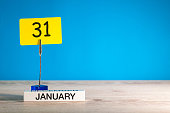 January 31st. Day 31 of january month, calendar on blue background. Winter time. Empty space for text, mock up.
