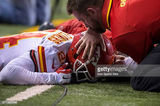 Kansas City Chiefs cornerback Brandon Flowers appears to hit the ground hard for a possible head injury and is attend by a Kansas City Chiefs medical...