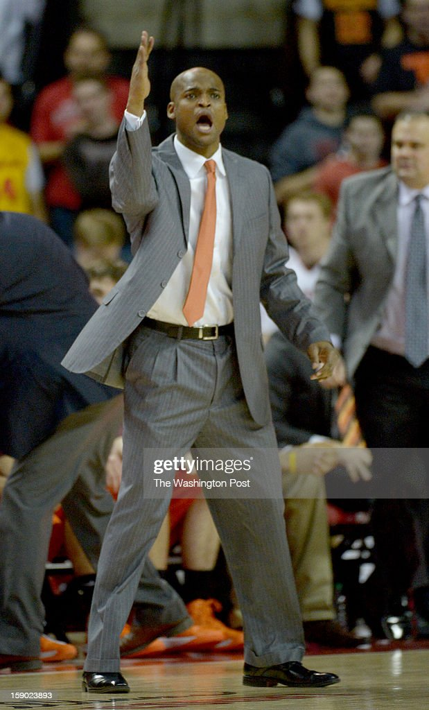Virginia Tech head coach James Johnson works during 1st half action against the Maryland Terrapins on January 5, 2013 in College Park, MD