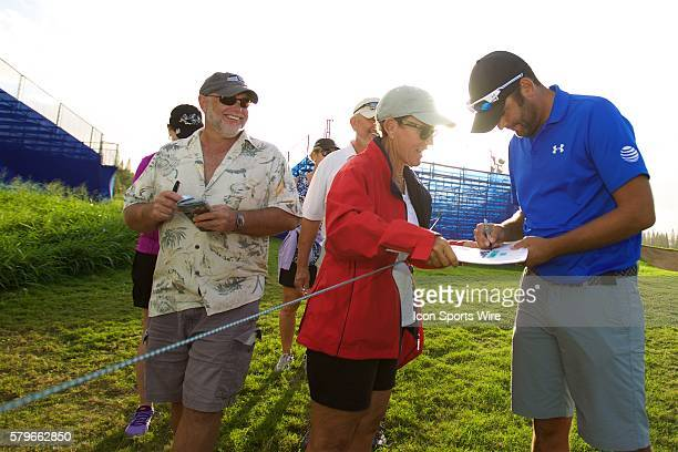 Jordan Spieth's caddie Michael Greller signs an autograph after their ProAm round Final Round of the Hyundai Tournament of Champions at Kapalua...