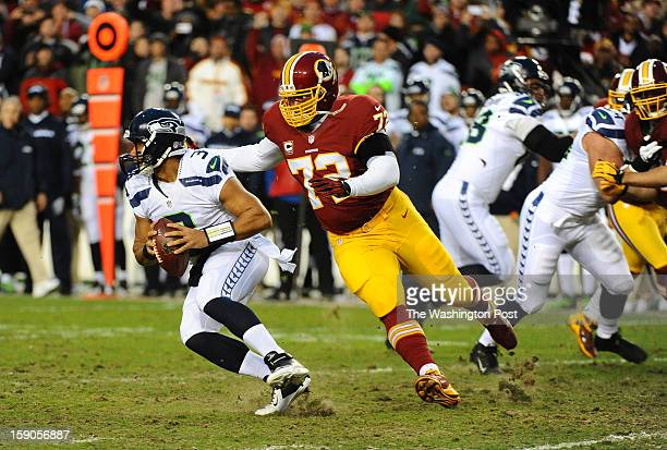 Washington Redskins defensive end Stephen Bowen moves in to sack Seattle Seahawks quarterback Russell Wilson in the first quarter at FedEx field on...