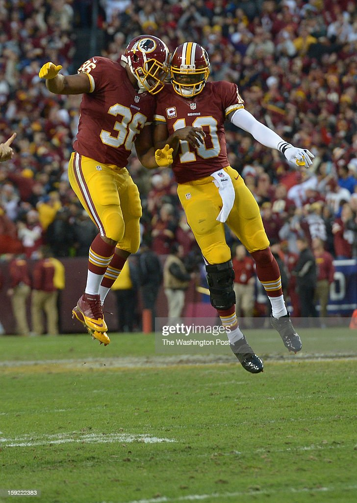 Washington Redskins quarterback Robert Griffin III (10) was flying high when he bumped fullback Darrel Young (36) following a first quarter touchdown against the Seattle Seahawks at FedEx field on January 6, 2013 in Landover, MD