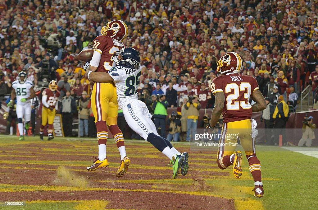Washington Redskins strong safety Reed Doughty (37) breaks up and almost intercepts an attempted touchdown pass intended for Seattle Seahawks wide receiver Doug Baldwin (89) in the first half at FedEx field on January 6, 2013 in Landover, MD