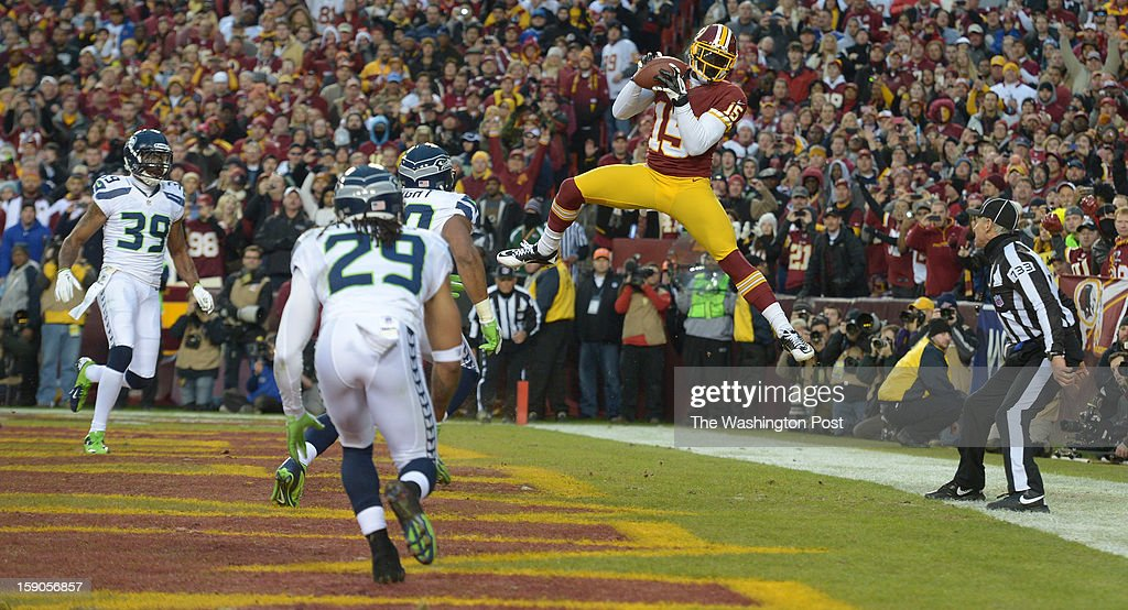 Washington Redskins wide receiver Josh Morgan (15) makes a catch in the endzone but was unable to keep both feet in bounds early in the first quarter against the Seattle Seahawks at FedEx field on January 6, 2013 in Landover, MD