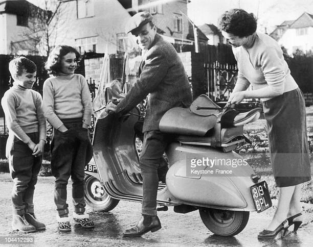 January 9 1957 A jockey by the name of Harry SPRAGUE climbing on his VESPA moped to go to the racetrack while his children and wife stood by He...