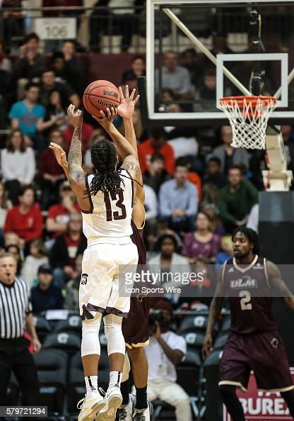 Arkansas Little Rock Trojans guard Marcus Johnson Jr shoots a three point shot during an NCAA basketball game between the University Louisiana Monroe...
