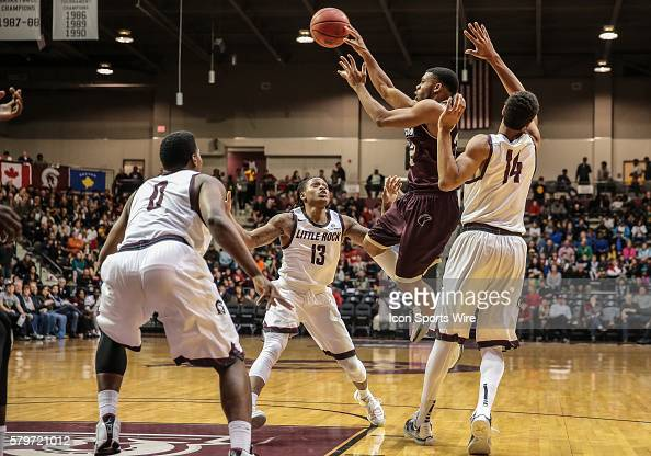 Louisiana Monroe Warhawks guard Justin Roberson passes while surrounded by Arkansas Little Rock Trojans forward Mareik Isom Arkansas Little Rock...