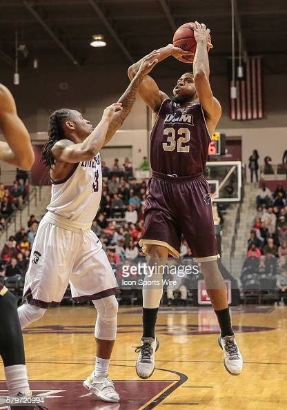 Louisiana Monroe Warhawks guard Justin Roberson shoots over Arkansas Little Rock Trojans guard Marcus Johnson Jr during an NCAA basketball game...