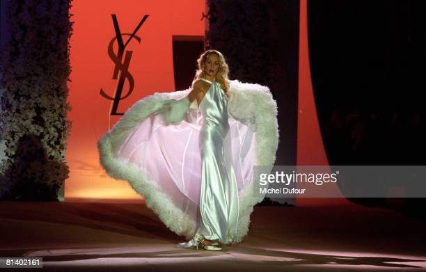 Model Jerry Hall walks on the catwalk atthe last YSL High Fashion Show Spring/Summer 2002 during the fashion week 2002 in Paris France