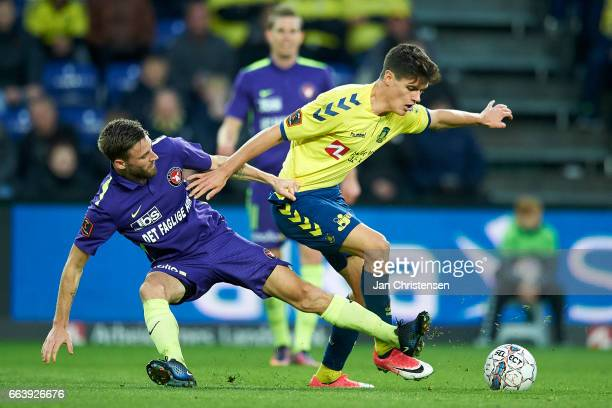 Janus Drachmann of FC Midtjylland and Christian Norgaard of Brondby IF compete for the ball during the Danish Alka Superliga match between Brondby IF...