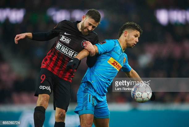 Janus Drachmann of FC Midtjylland and Emiliano Marcondes of FC Nordsjalland compete for the ball during the Danish Alka Superliga match between FC...