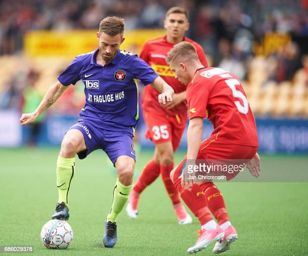 Janus Drachmann of FC Midtjylland and Mads Pedersen of FC Nordsjalland compete for the ball during the Danish Alka Superliga match between FC...