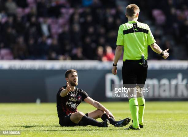 Janus Drachmann of FC Midtjylland talking with Referee Jorgen Daugbjerg Burchardt during the Danish Alka Superliga match between FC Midtjylland and...