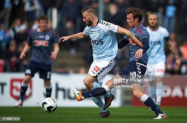 Janus Drachmann of Sonderjyske and Elmar Bjarnason of AGF Aarhus compete for the ball during the Danish Alka Superliga match between Sonderjyske and...
