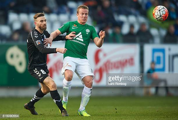 Janus Drachmann of Sonderjyske and Jeppe Curth of Viborg FF compete for the ball during the Danish Alka Superliga match between Viborg FF and...