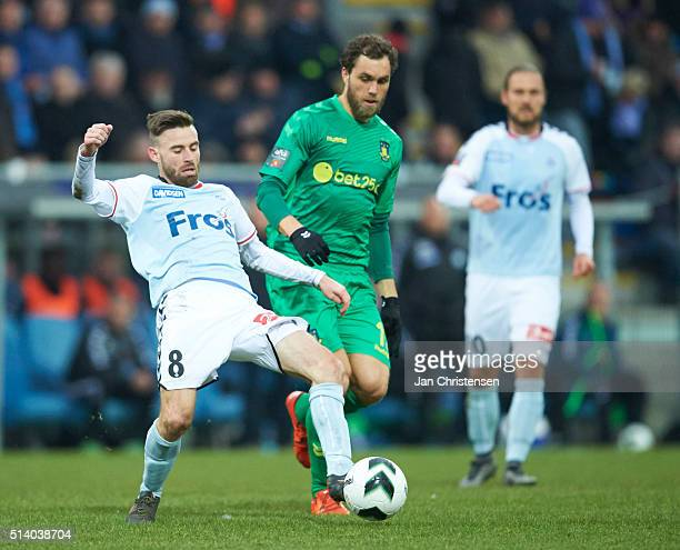 Janus Drachmann of SonderjyskE and Johan Elmander of Brondby IF compete for the ball during the Danish Alka Superliga match between SonderjyskE and...