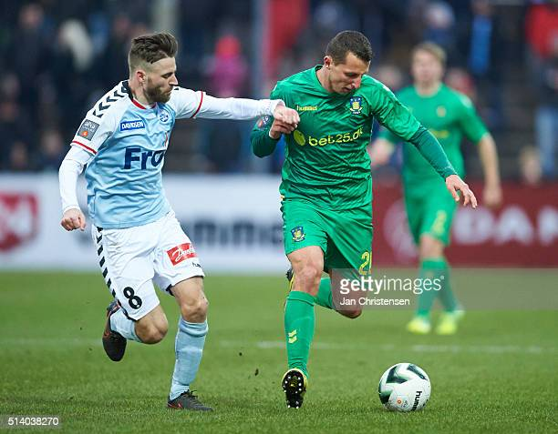 Janus Drachmann of SonderjyskE and Kamil Wilczek of Brondby IF compete for the ball during the Danish Alka Superliga match between SonderjyskE and...