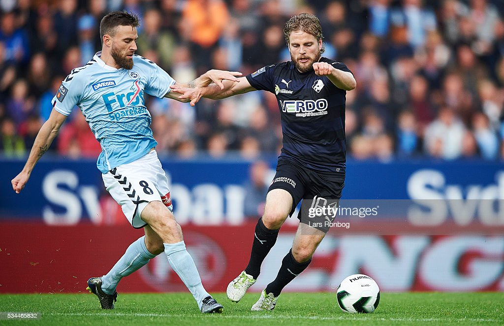 Janus Drachmann of Sonderjyske and Kasper Fisker of Randers FC compete for the ball during the Danish Alka Superliga match between Sonderjyske and Randers FC at Sydbank Park on May 26, 2016 in Haderslev, Denmark.