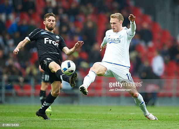 Janus Drachmann of SonderjyskE and Nicolai Jorgensen of FC Copenhagen compete for the ball during the Danish Alka Superliga match between FC...