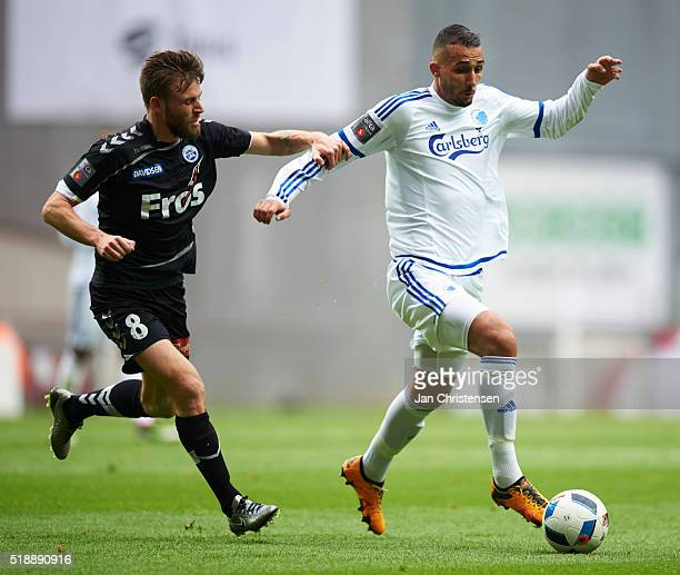 Janus Drachmann of SonderjyskE and Youssef Toutouh of FC Copenhagen compete for the ball during the Danish Alka Superliga match between FC Copenhagen...