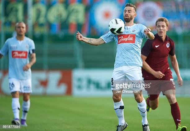 Janus Drachmann of SonderjyskE compete for the ball during the UEFA Europa League Playoff match between SonderjyskE and AC Sparta Praha at Sydbank...