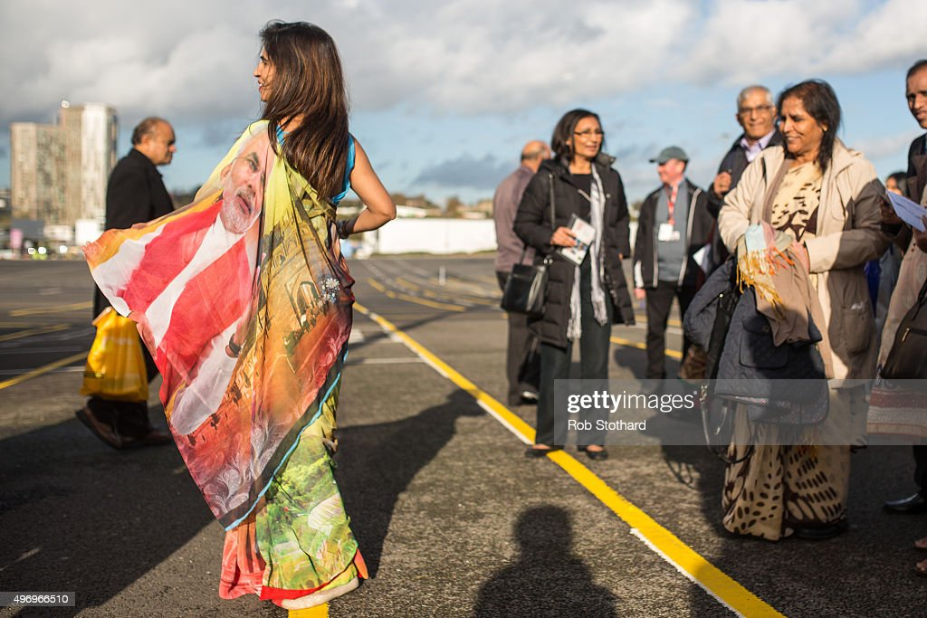 Janya Darbar from Leicester wears a Sari featuring a portrait of Indian Prime Minister Narendra Modi outside Wembley Stadium during the second day of an official three day visit on November 13, 2015 in London, England. In his first trip to Britain as Prime Minister Modi's visit will aim to develop economic ties between the two countries. In a busy schedule he will speak at Wembley Stadium, lunch with the Queen at Buckingham Palace, address Parliament and stay overnight at Chequers.