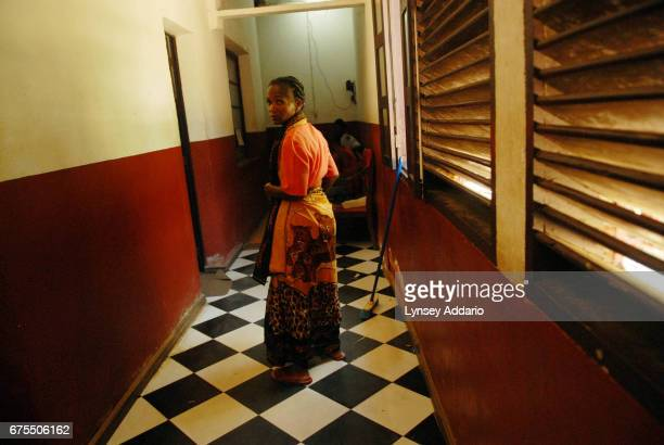 Jaozandry Mbotiliza the mother of Kenia Moravelo walks through the courthouse in search of information about how her daughter's rape case disappeared...