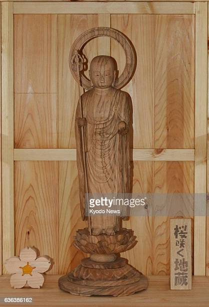 SENDAI Japan A 60centimetertall Jizo a guardian deity of children made of wood from two cherry trees that temporarily survived the March 2011 massive...