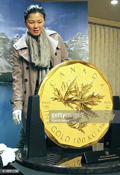 SAPPORO Japan A gold coin weighing 100 kilograms is exhibited at a Hokkaido hotel on Nov 16 to mark the 30th anniversary of the sale of Canadian gold...