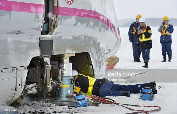 DAISEN Japan A Japan Transport Safety Board inspector examines the area around a wheel of a bullet train in Daisen Akita Prefecture on March 3 that...