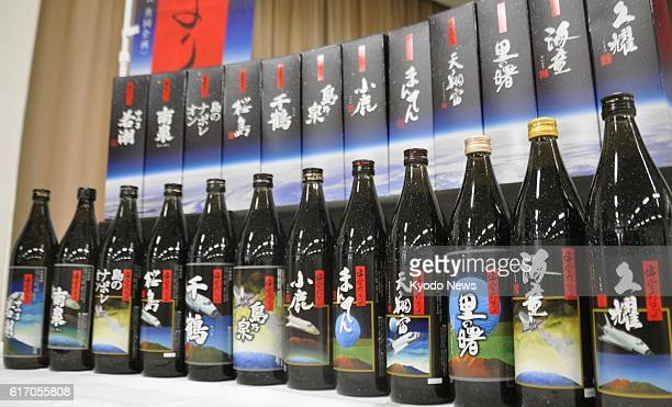 KAGOSHIMA Japan A line of bottled ''shochu'' distilled spirit made using rice malt and yeast kept on the International Space Station is displayed at...