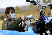 KAWAMATA Japan A man checks radiation levels of a bicycle in Kawamata Fukushima Prefecture on April 10 after it was transported from the area within...